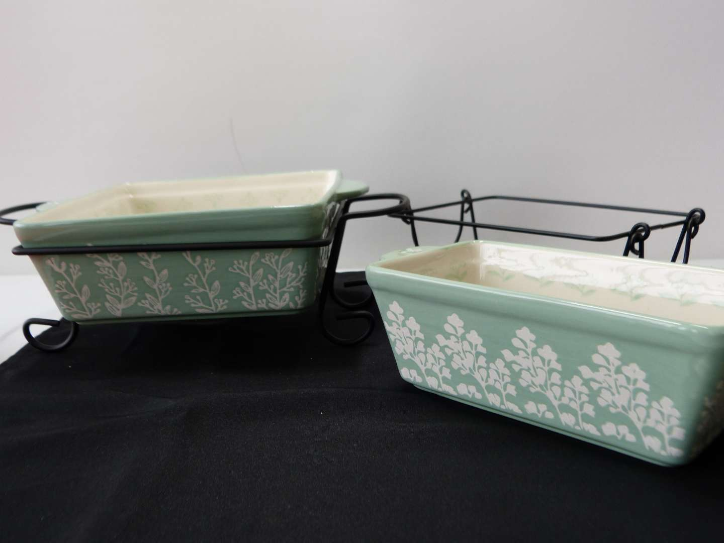 Lot # 42  2 Hauswarming  loaf pans with metal holders (one does not go to the dish)