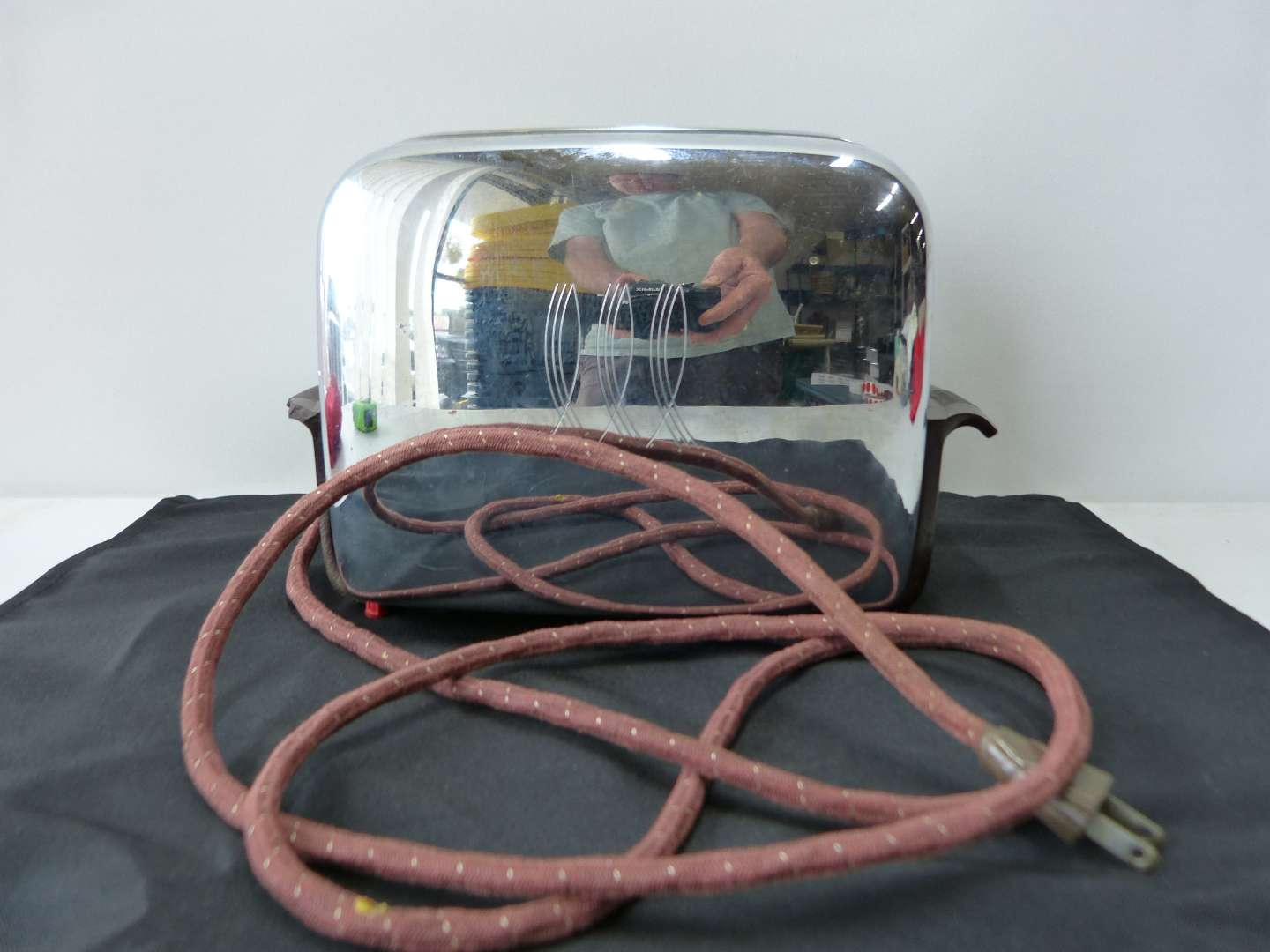 Lot # 46  Vintage cloth cord stainless toaster (working condition) one handle has a break (see picture)