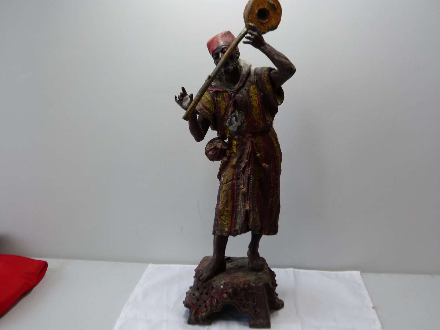 Lot # 65  Cast Iron hand painted street musician (shows some damage)