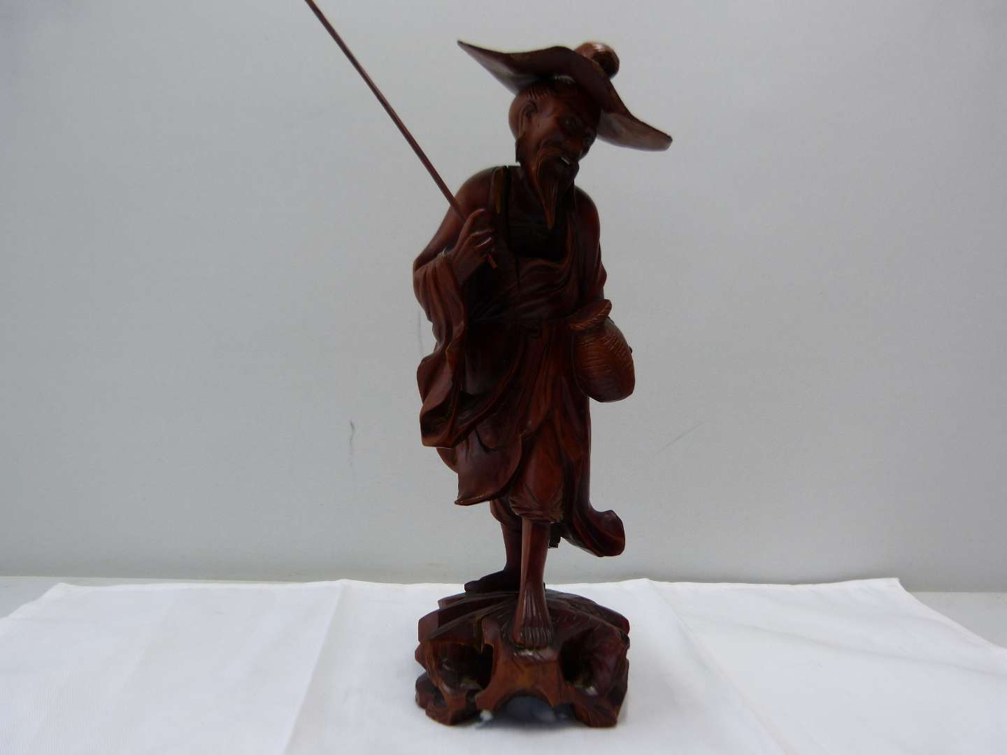 Lot # 92  Large wood carved Oriental peasant  (main image)