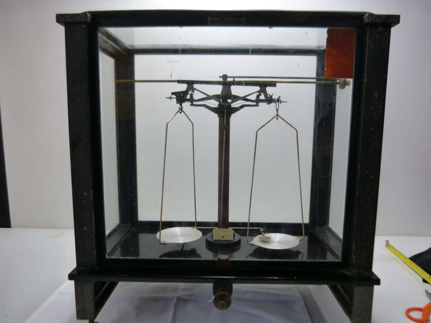 Lot # 2  Antique Fisher Scientific scale.  Metal framed and glass all around (does show some pitting on the frame)