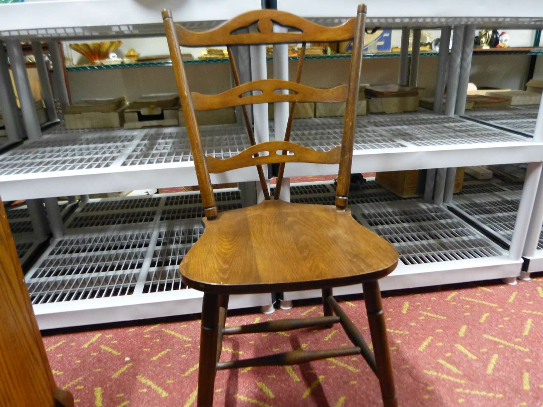 Lot # 9  Antique split back wood occasional chair
