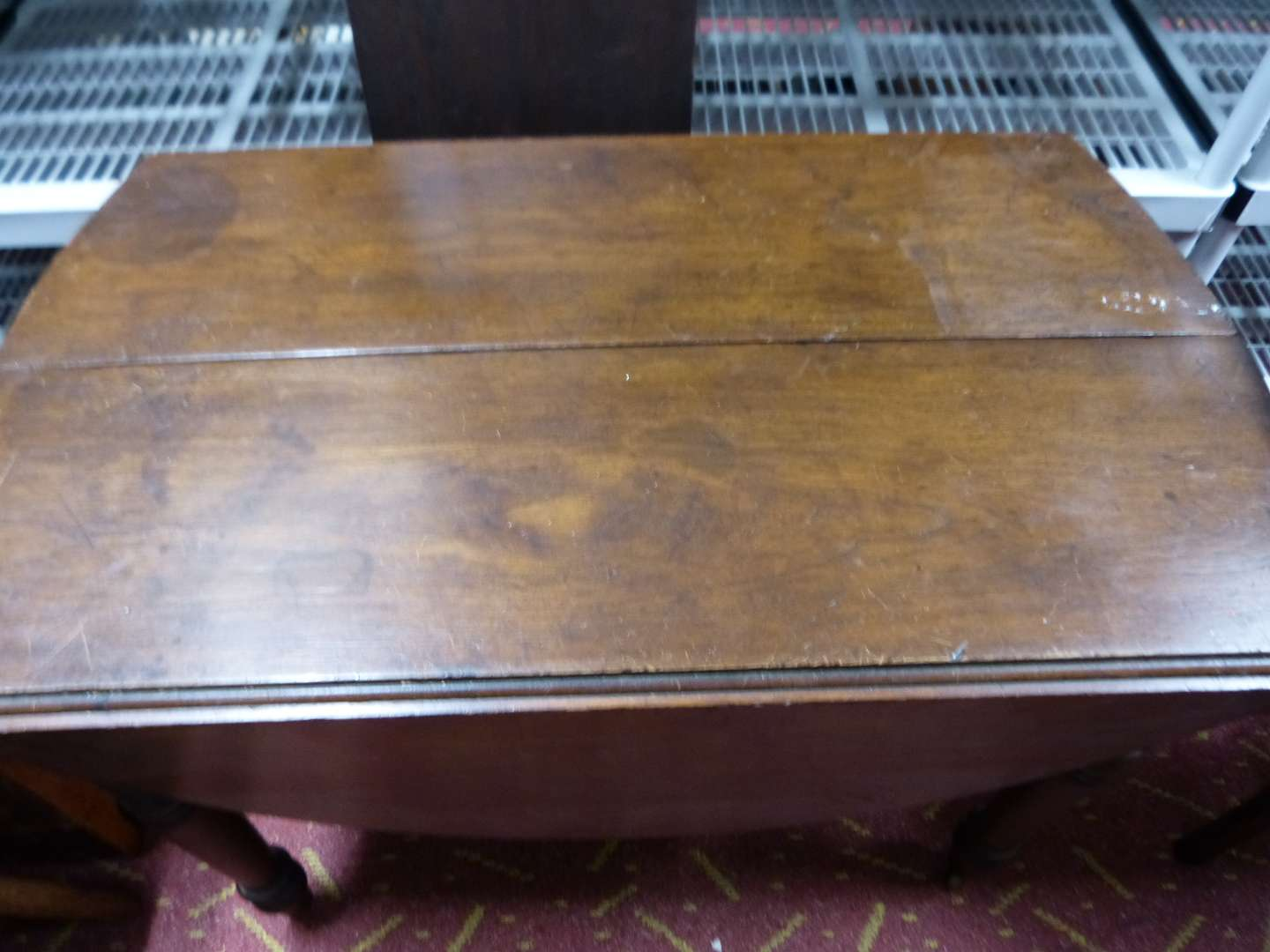 Lot # 10  SOLID walnut antique drop leaf oval table w/leaf (I don't think the leaf is original) HEAVY & great condition (5th leg