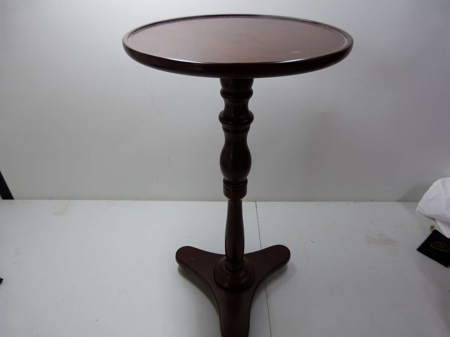 Lot # 113  Side occasional round wood table in mahogany