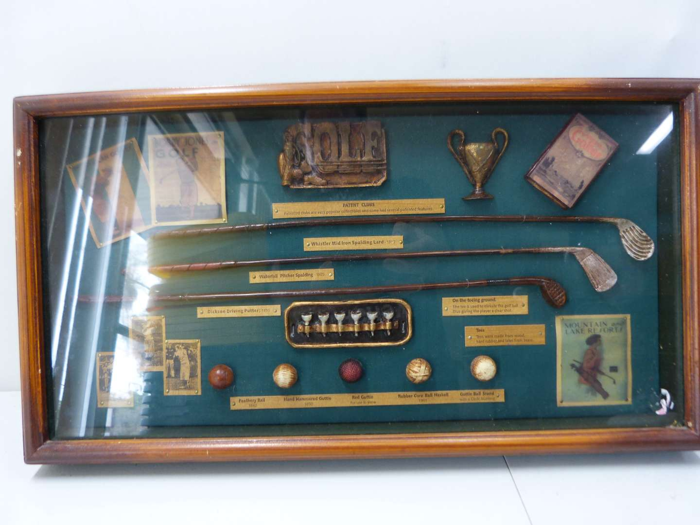 Lot # 151  Very nice Golf Shadow Box with lots of interesting things displayed