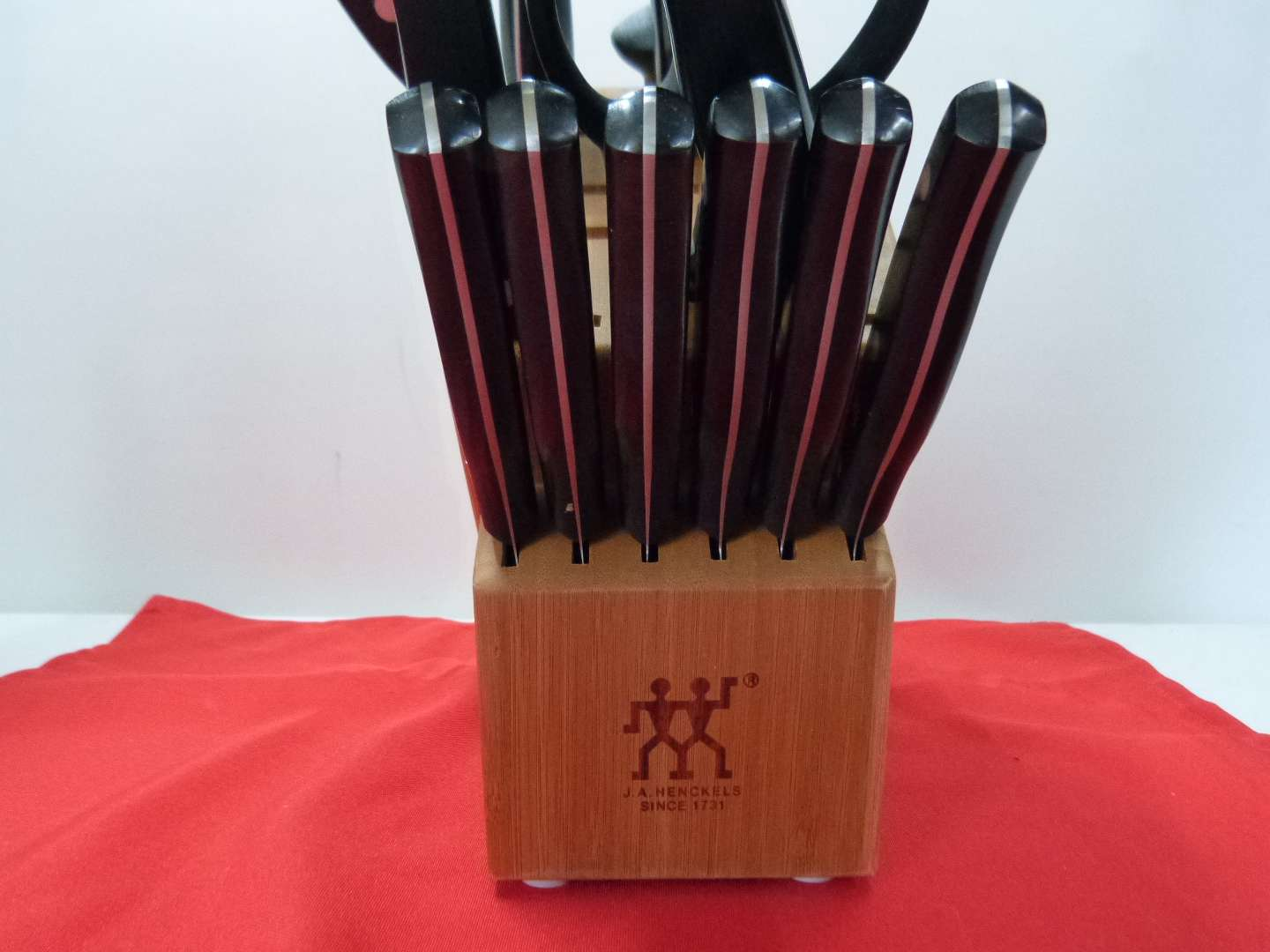 Lot # 157  Collection of J.A. Henckel knives with block (not complete but nice condition)