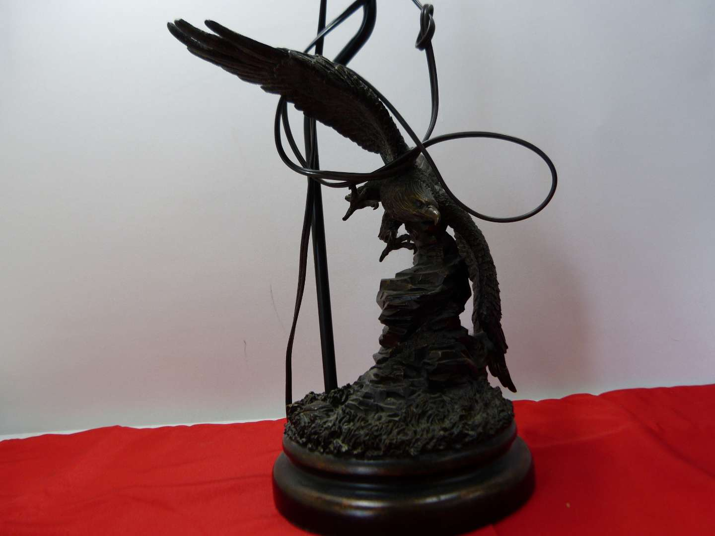 Lot # 166  Great Eagle lamp (resin) with Eagle finial (one feather is partially missing)