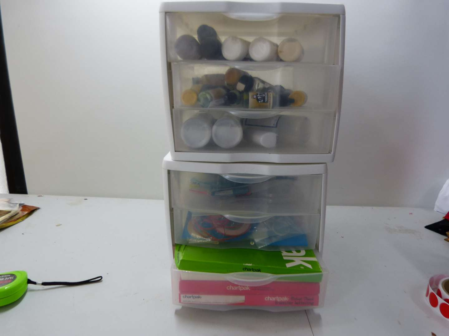Lot # 179  4 drawer cabinet with content LOTS of paints etc