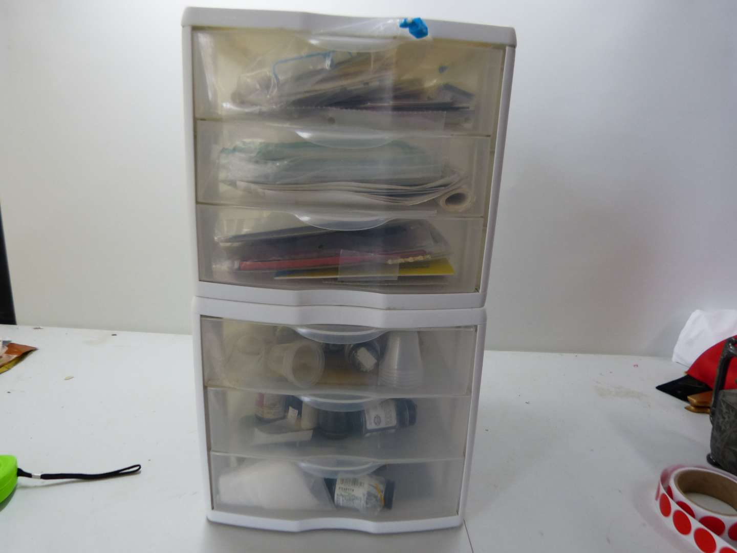 Lot # 180  4 drawer cabinet with content LOTS of paints etc