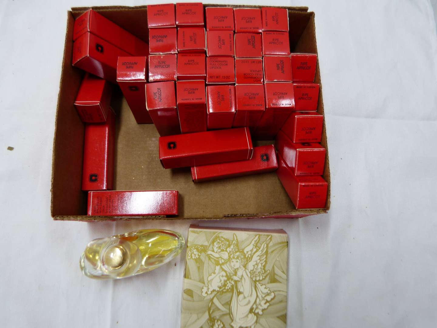 Lot # 200   LARGE lot Avon lipstick (all same color great for resellers) & ornament & perfume