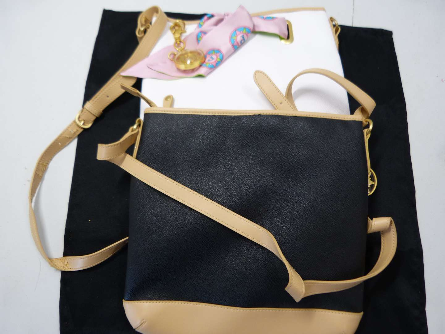 Lot # 202  2 Designer hand bags (one does have a scratch)