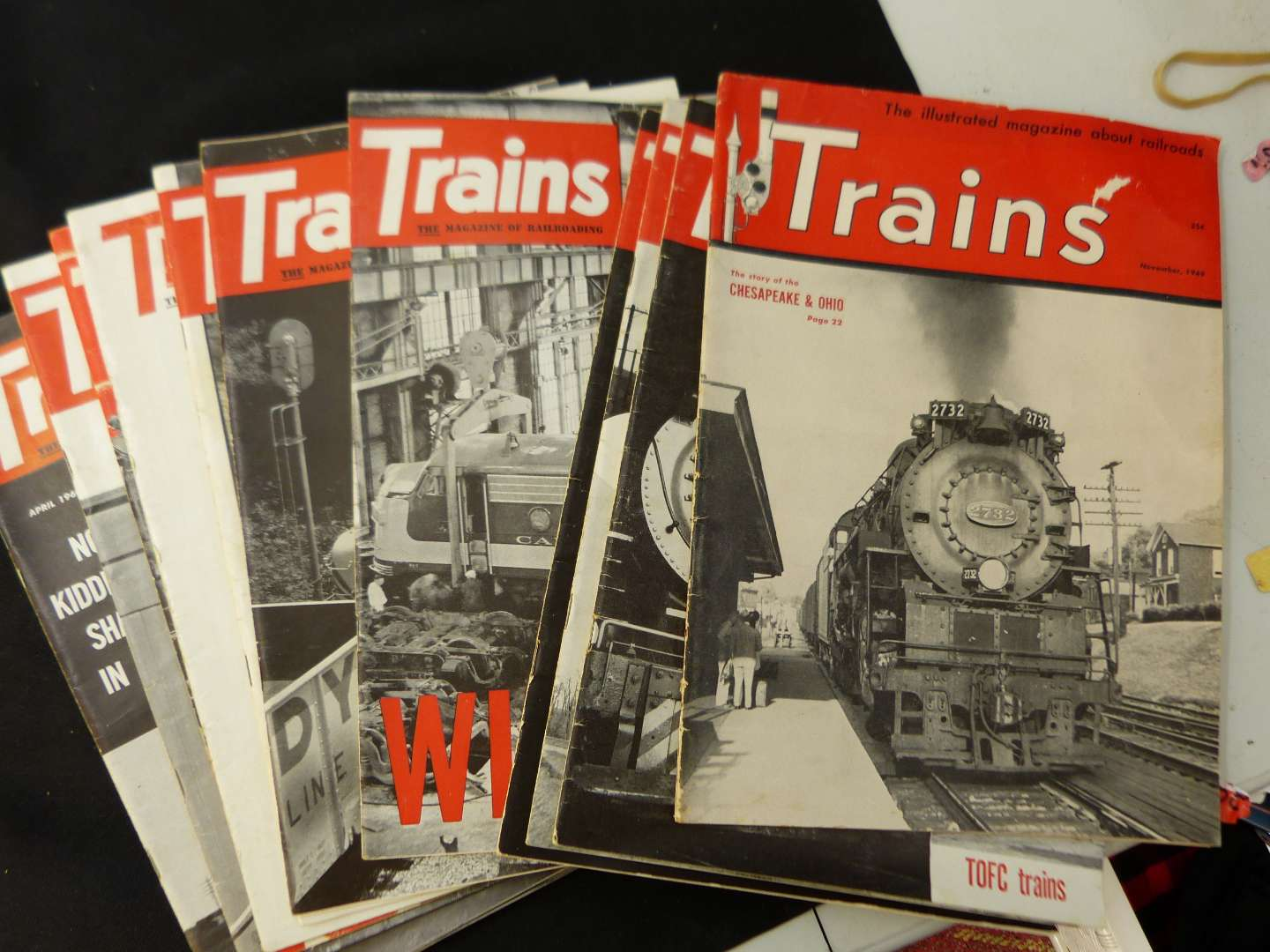 """Lot # 269  Trains """"The Magazine of Railroading"""" 1960 full year (magazines are complete-great advertising & stories)"""