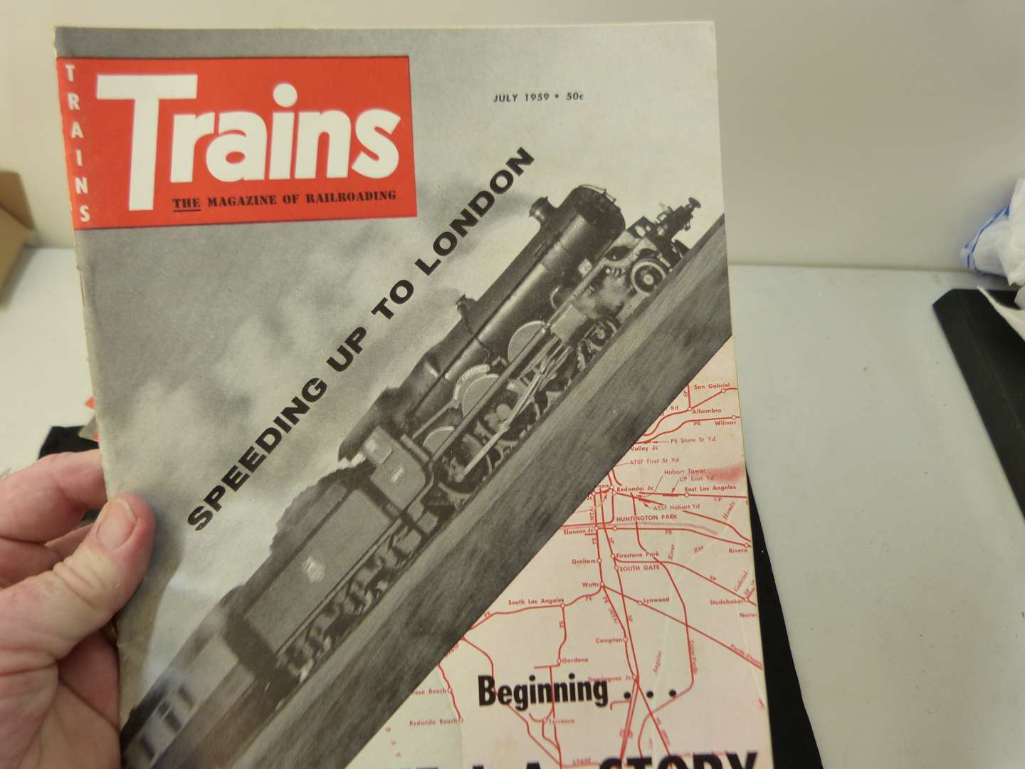 """Lot # 272  Trains """"The Magazine of Railroading"""" 1956 full year (magazines are complete-great advertising & stories)"""