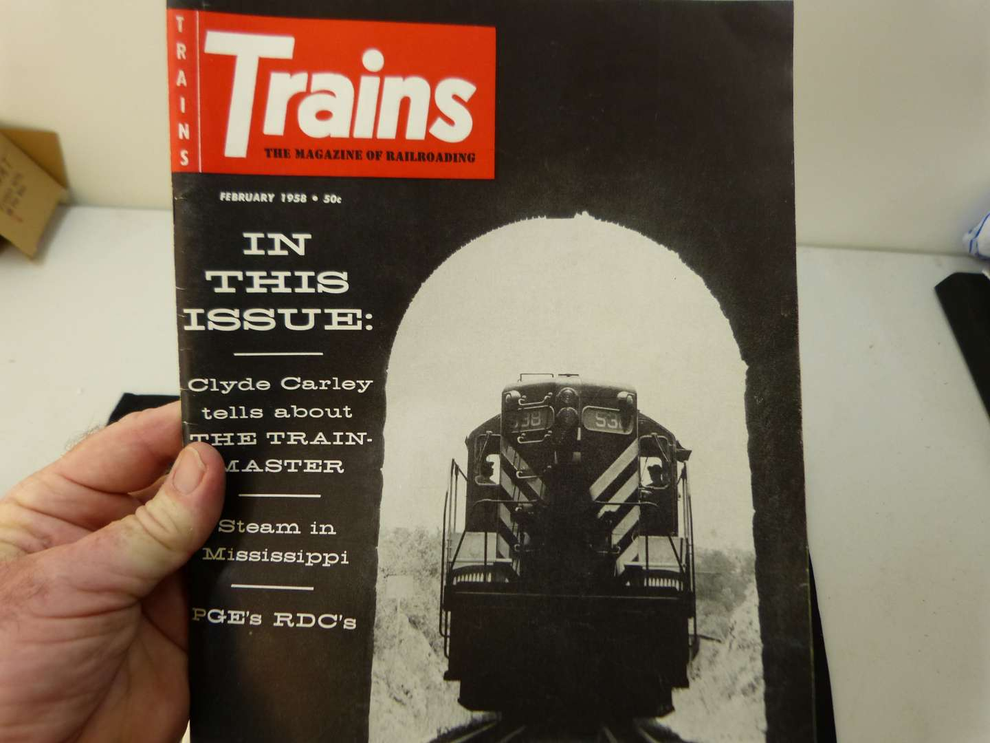 """Lot # 274  Trains """"The Magazine of Railroading"""" 1958 full year (magazines are complete-great advertising & stories)"""