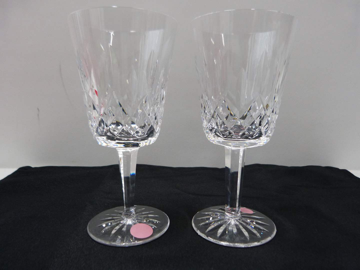 Lot # 24  Pair signed Waterford water glasses (Lismore pattern)