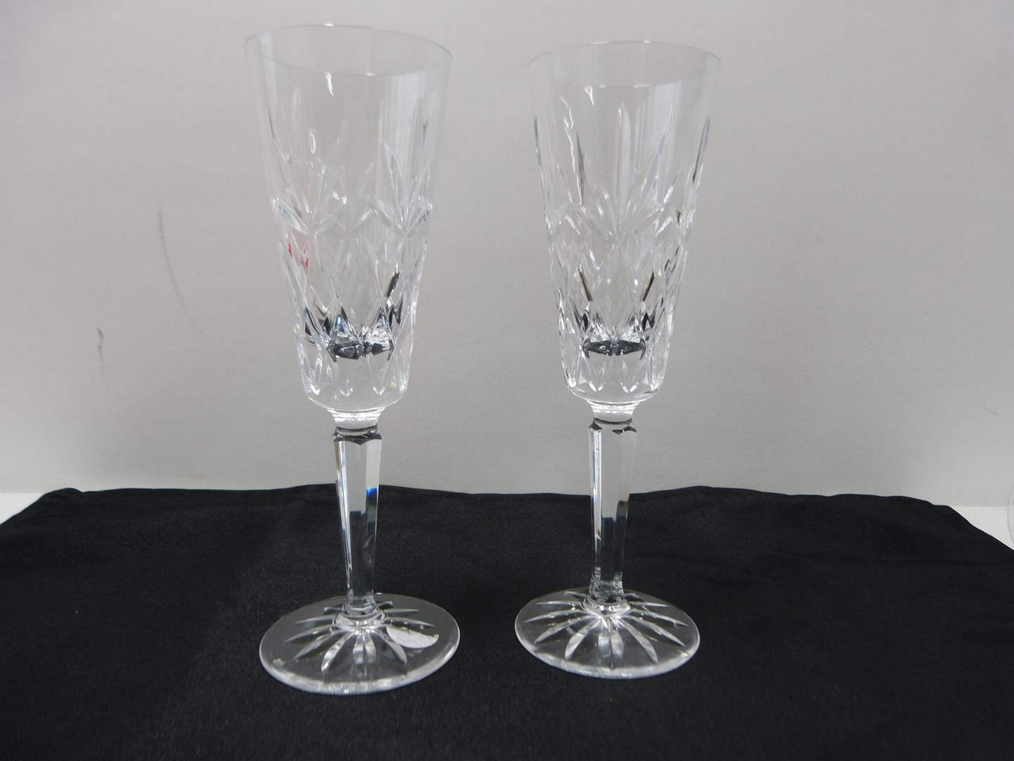 Lot # 27  Pair signed Waterford champagne flutes (Lismore pattern)