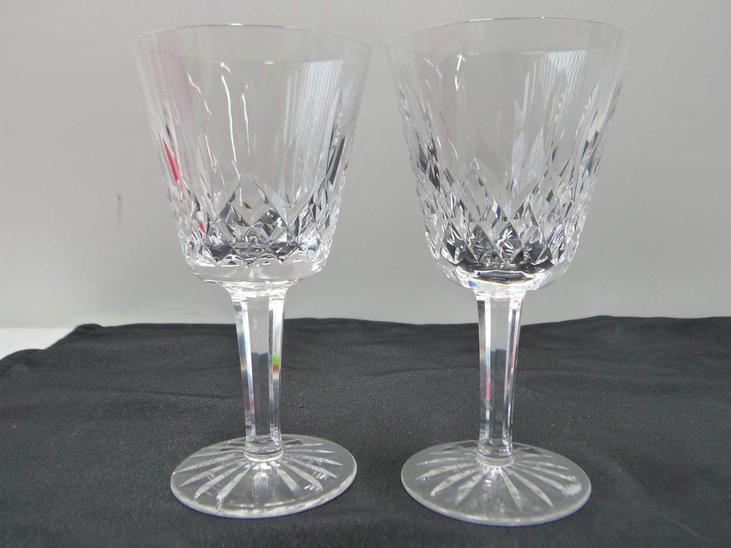 Lot # 32  2 Waterford Lismore pattern wine glasses