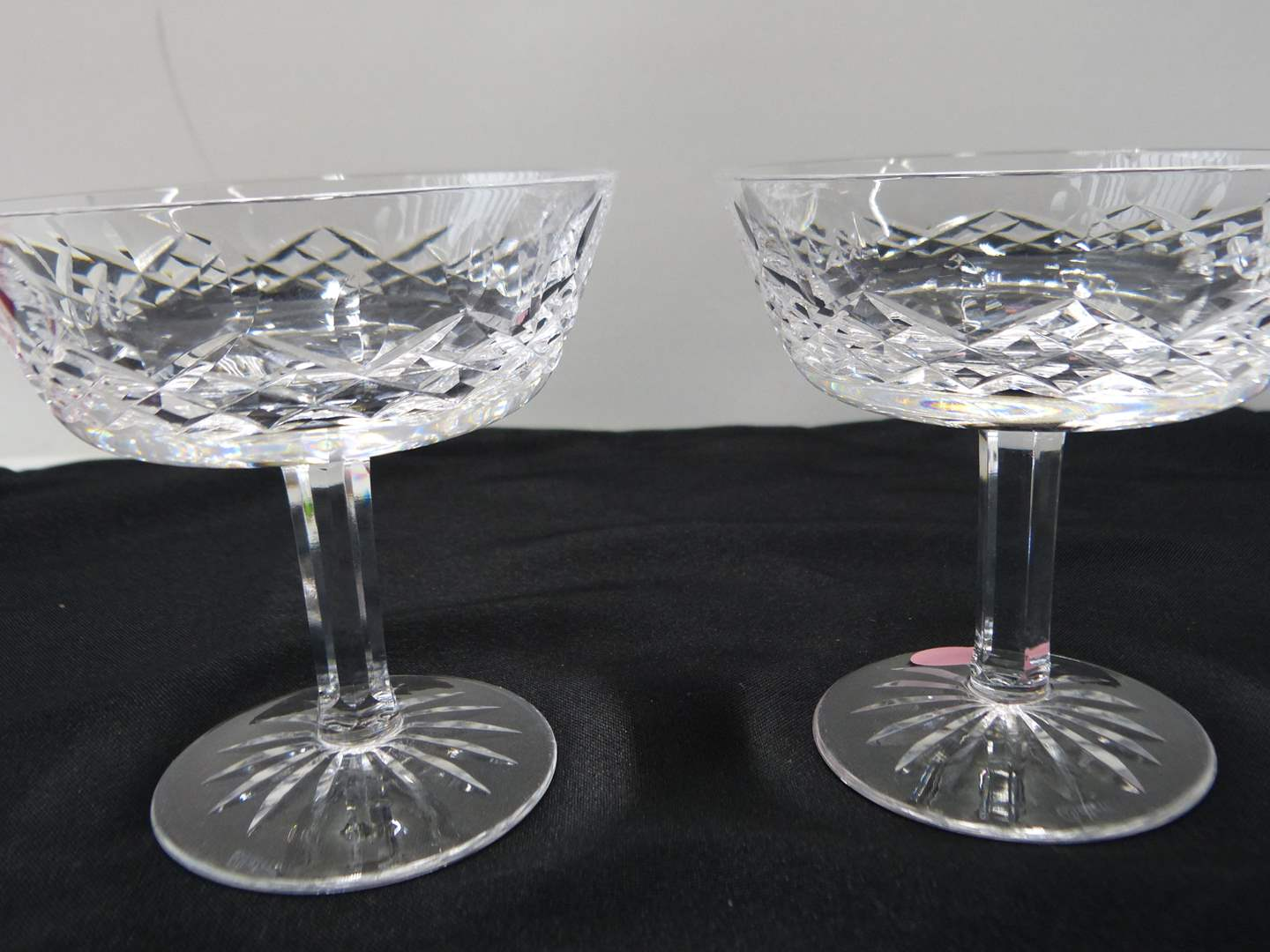 Lot # 34  Pair Waterford Lismore pattern champagne/toast glasses (could also be used as sherbet glasses
