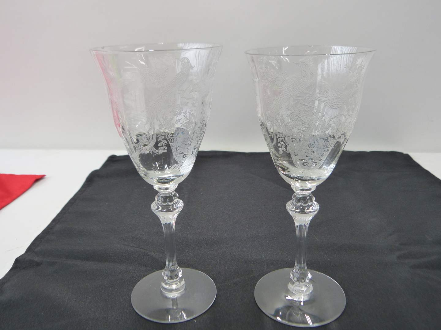 Lot # 35  Pair glass etched Peacock glasses (they both have a small chip but still HIGHLY collectible)