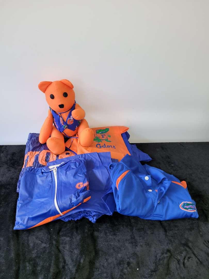 Lot # 79 Gator Memorabilia - Rain Coats, Shirt & Bear