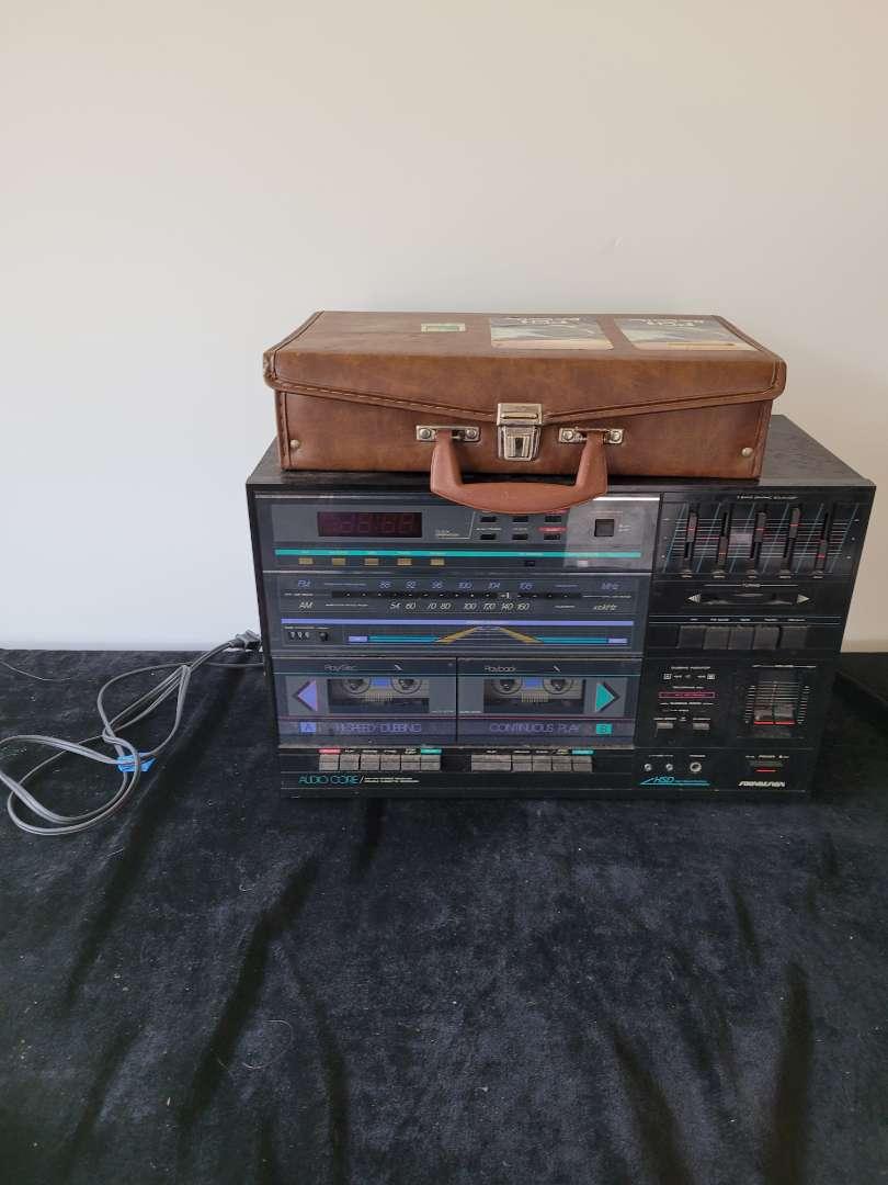 Lot # 281 Audio Core Duel Cassette/Radio Player w/ Cassette Tapes