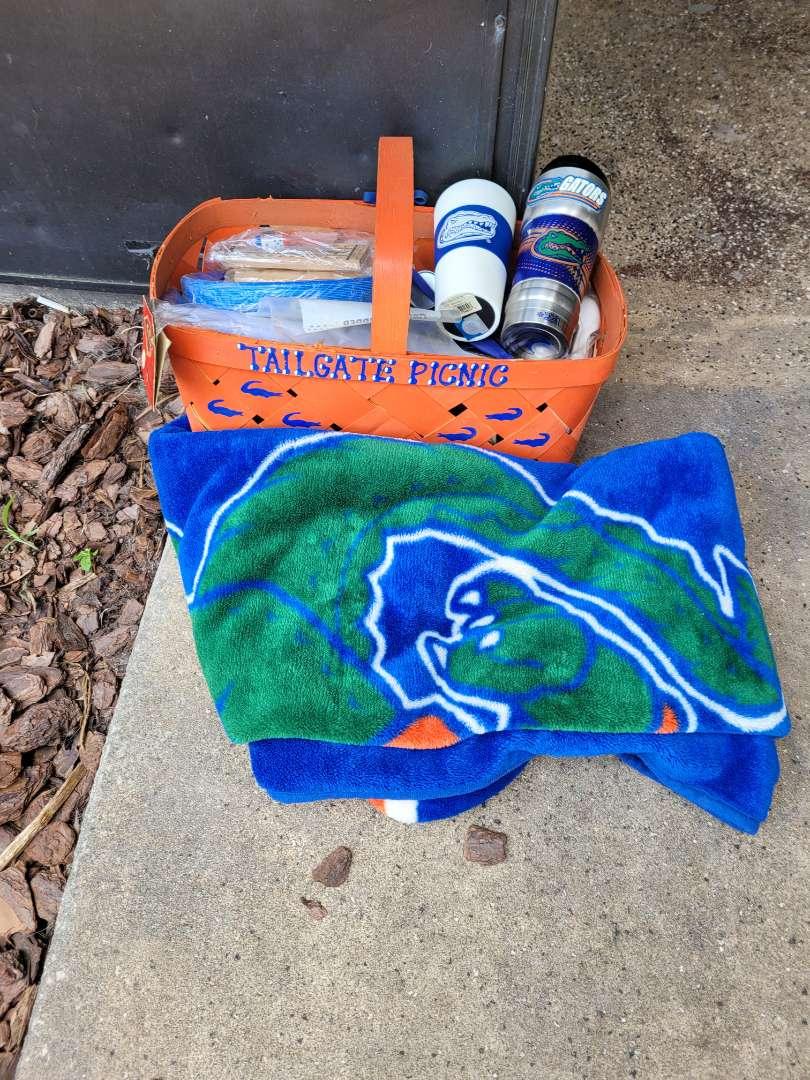 Lot # 416 Gator Basket w/ Supplies, Throw Blanket & Mugs