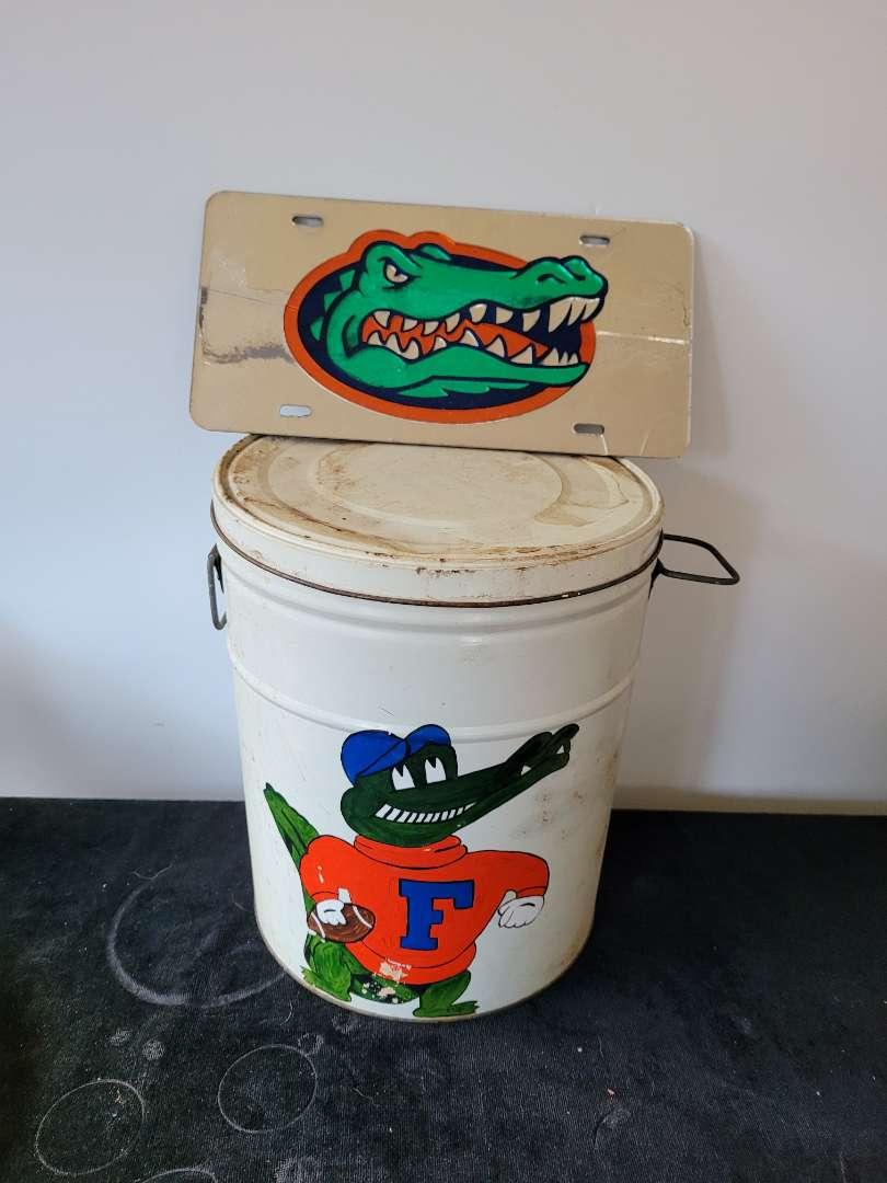 Lot # 418 Vintage Metal Gators Garbage Can w/ Lid & License plate