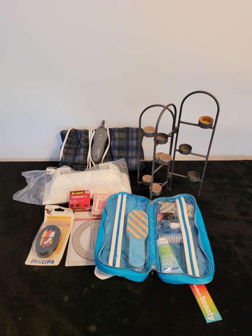 Lot # 489 Heating Pad, Candle Holders, Pedicure Set & More