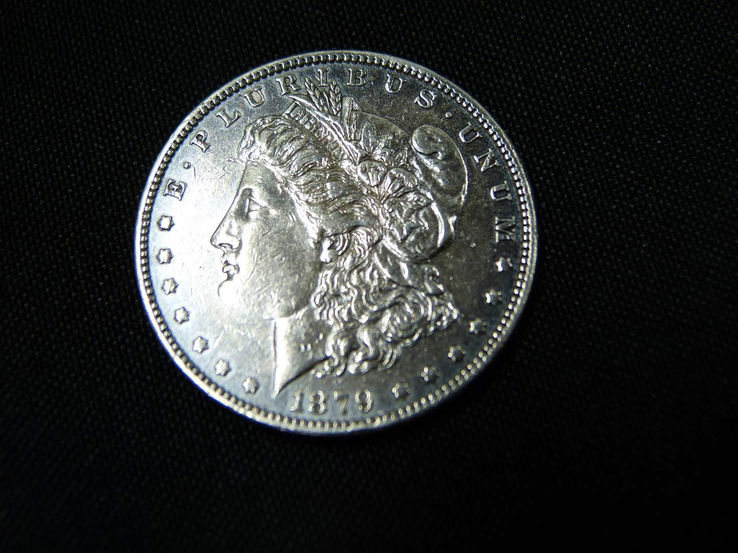Lot # 9  1879 Silver Morgan Dollar (improperly cleaned) 90 % Silver (main image)