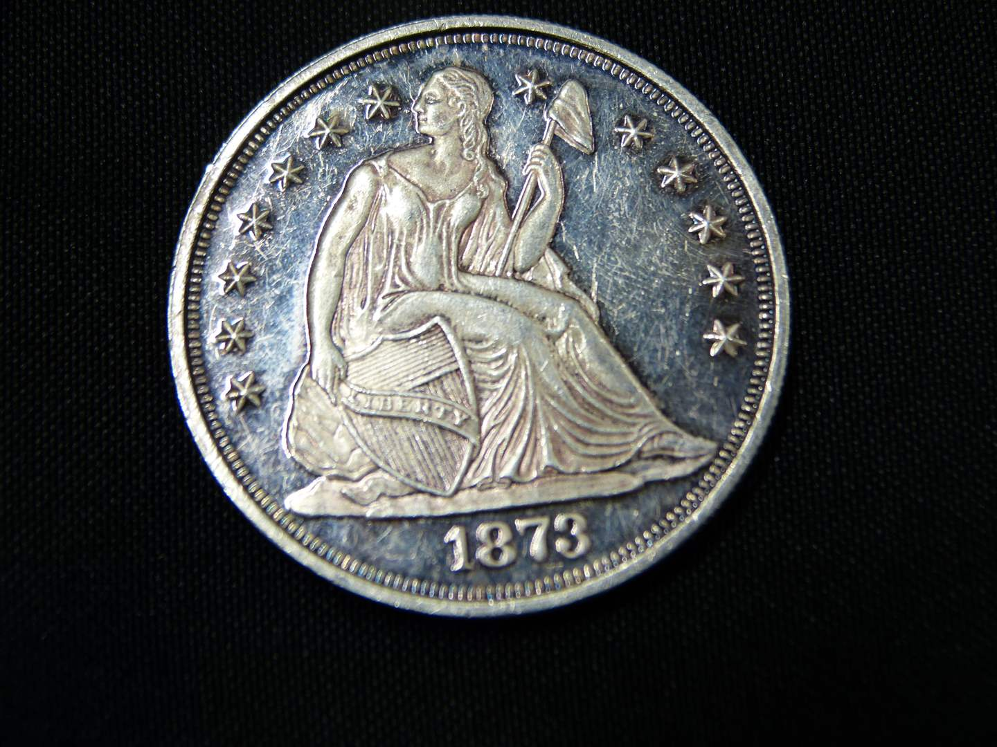 Lot # 10  2 ounces of .999 silver (cast into a 1876 copy sitting Liberty)  Guaranteed to be .999 2 ounces of silver (main image)