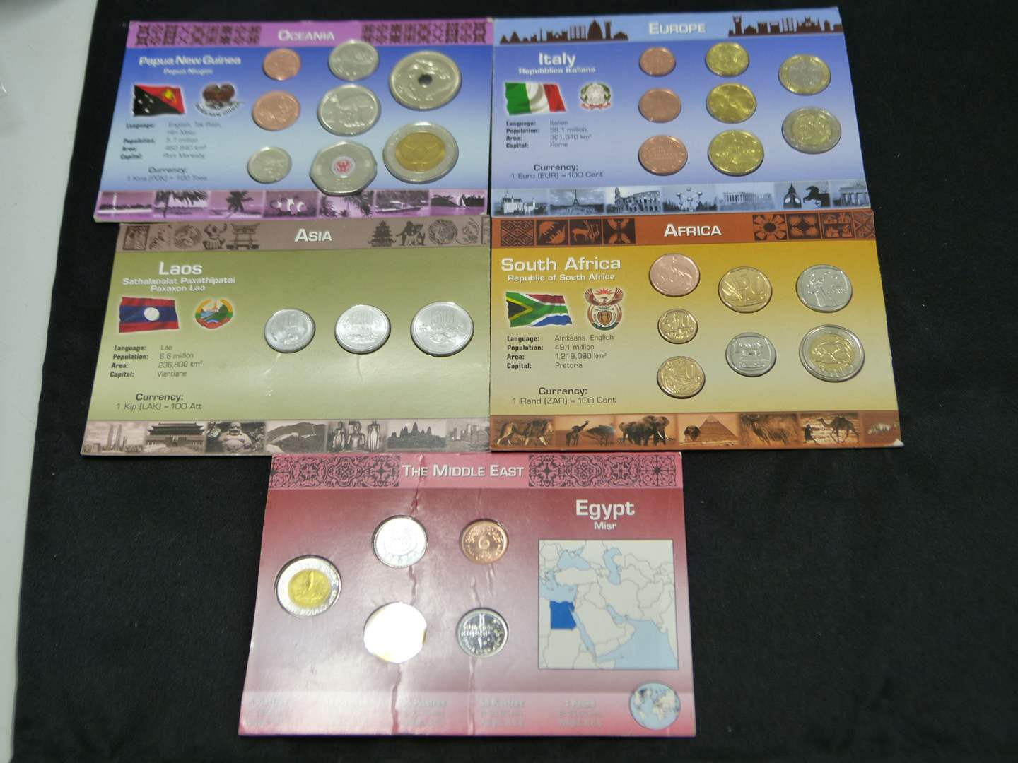 Lot # 23  Nice lot of uncirculated foreign coins (main image)