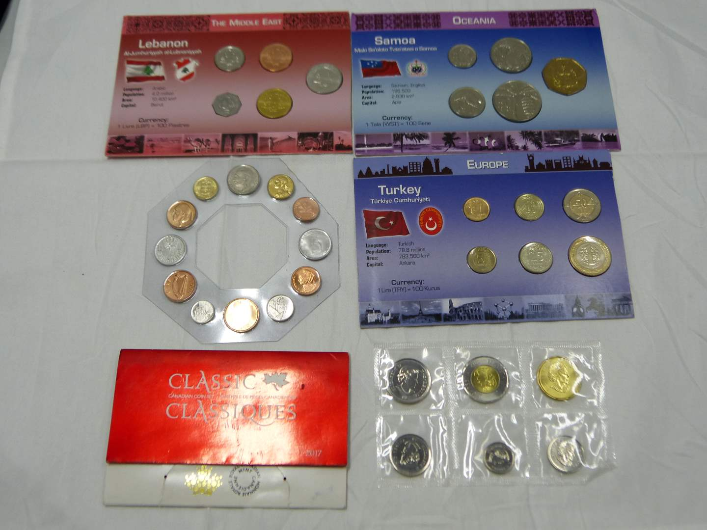 Lot # 24  Nice lot of uncirculated foreign coins (main image)