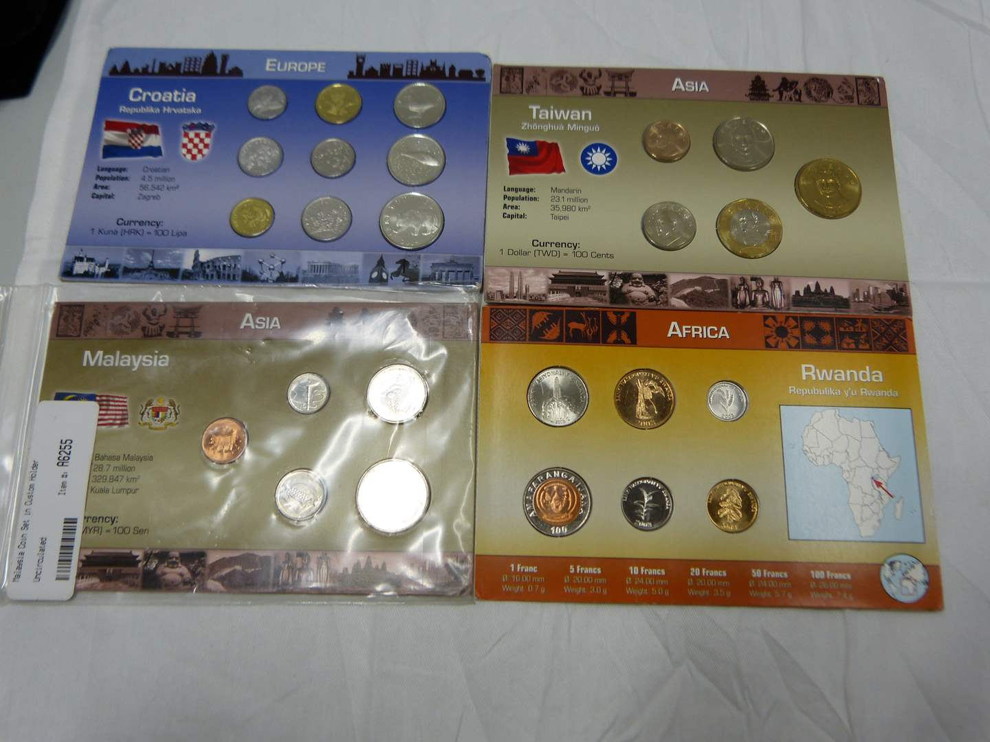 Lot # 25  Nice lot of uncirculated foreign coins (main image)