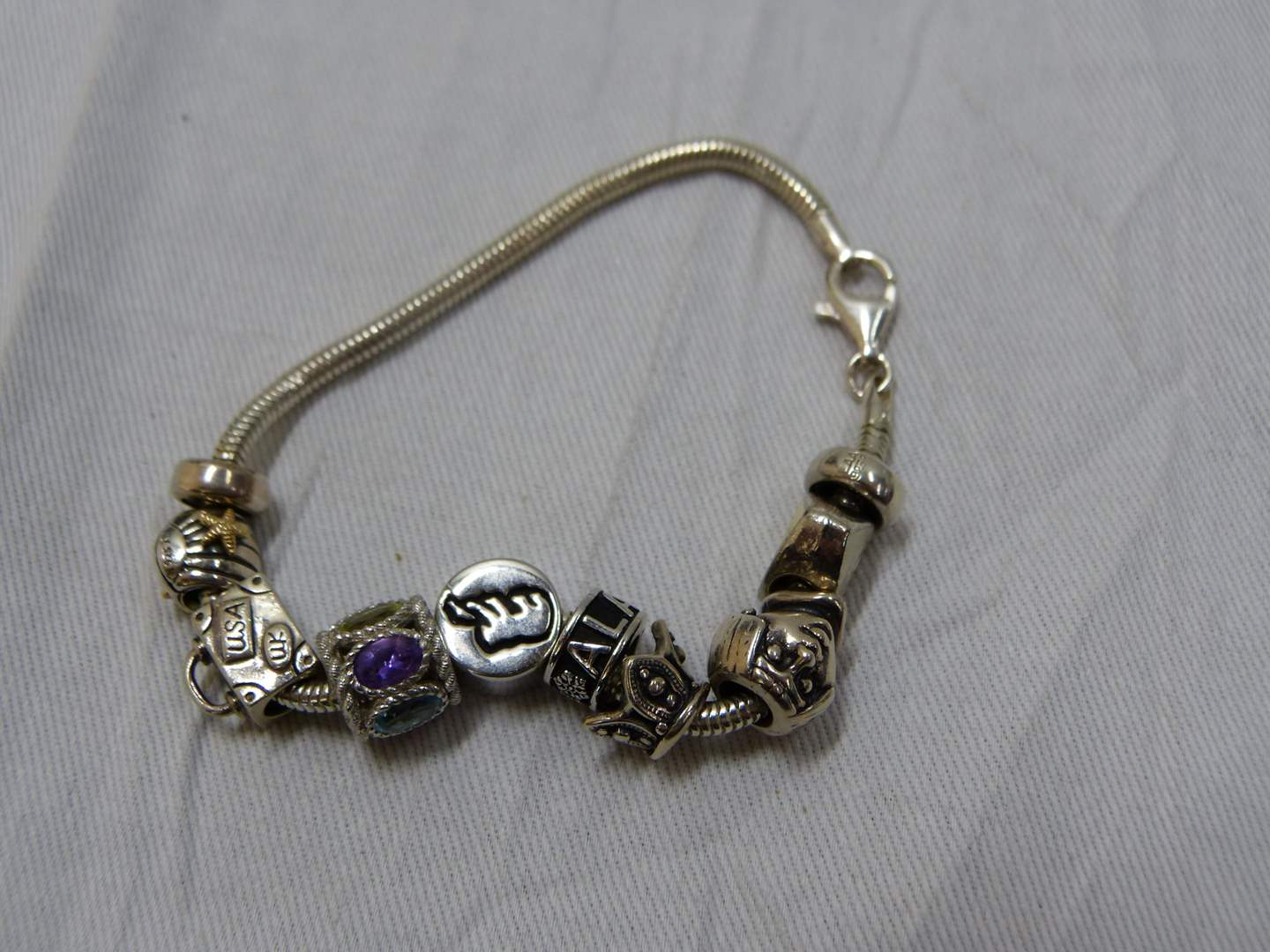 Lot # 75  Great sterling silver bracelet with slides to include Pandora & Judith Ripka (main image)