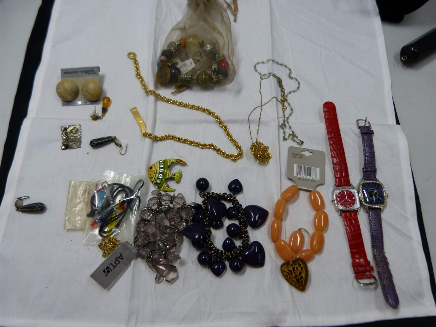 Lot # 81  Vintage lot of costume jewelry (check the pictures closely there are some nice things here)