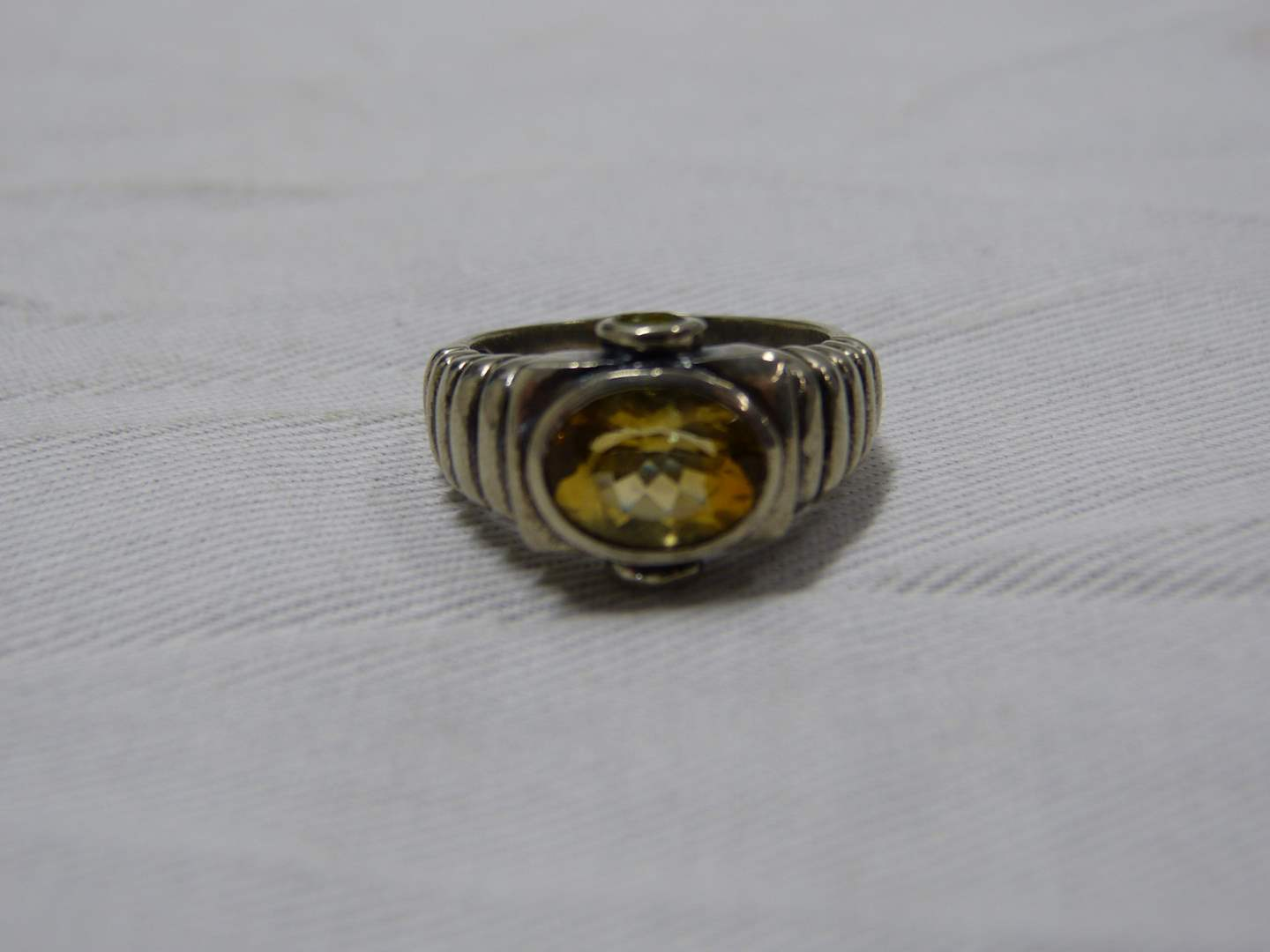 Lot # 89  Sterling silver ring with light topez stones including side stones size 8