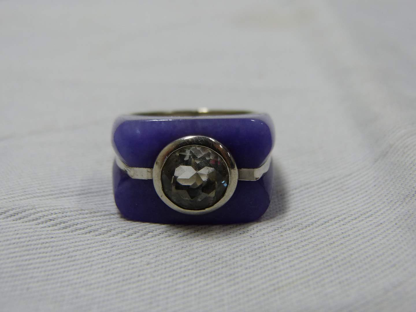 Lot # 90  Interesting sterling silver ring with purple accents and cz center stone size 8
