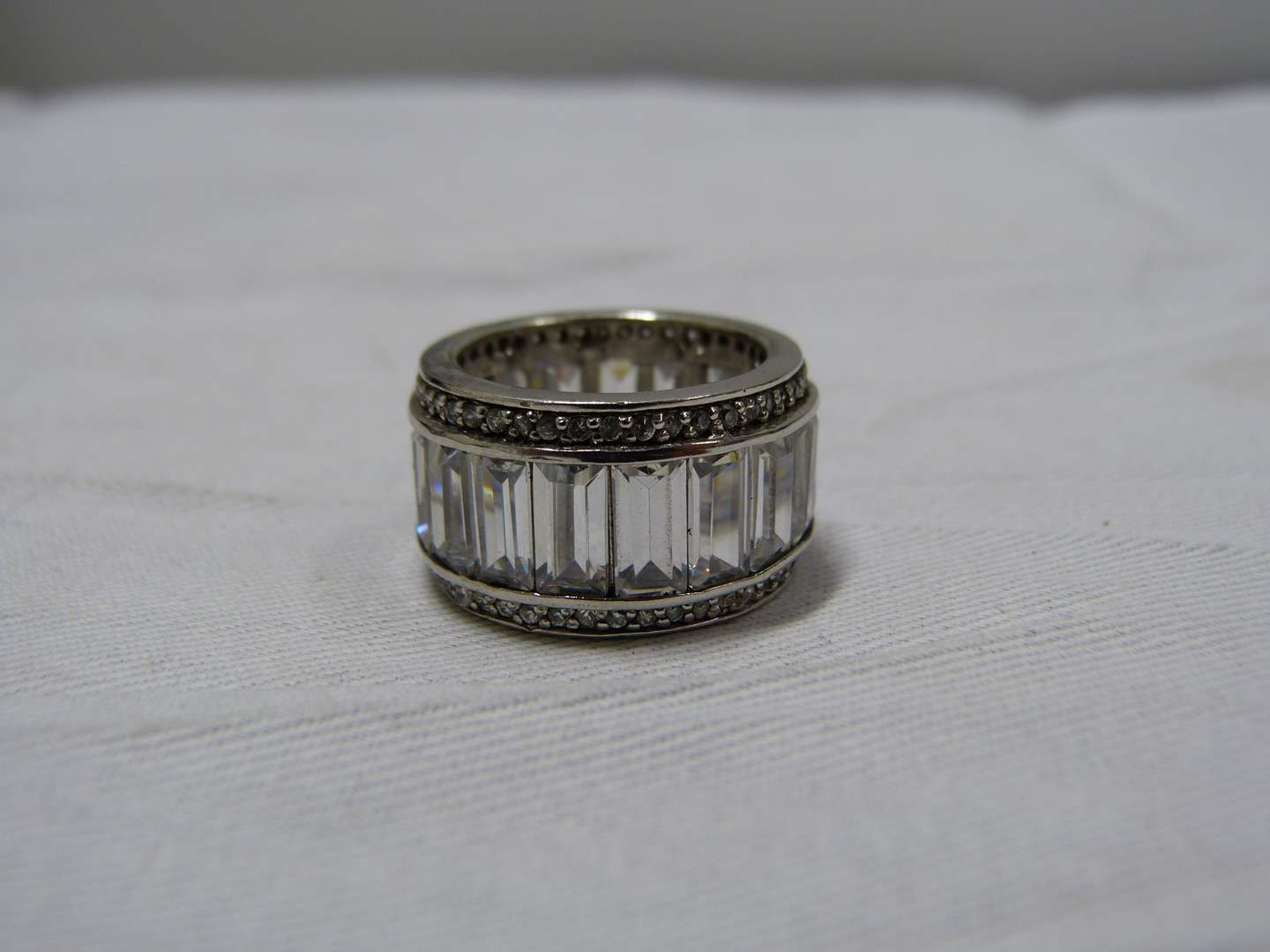 Lot # 95  Sterling silver and CZ band ring size 8 (main image)