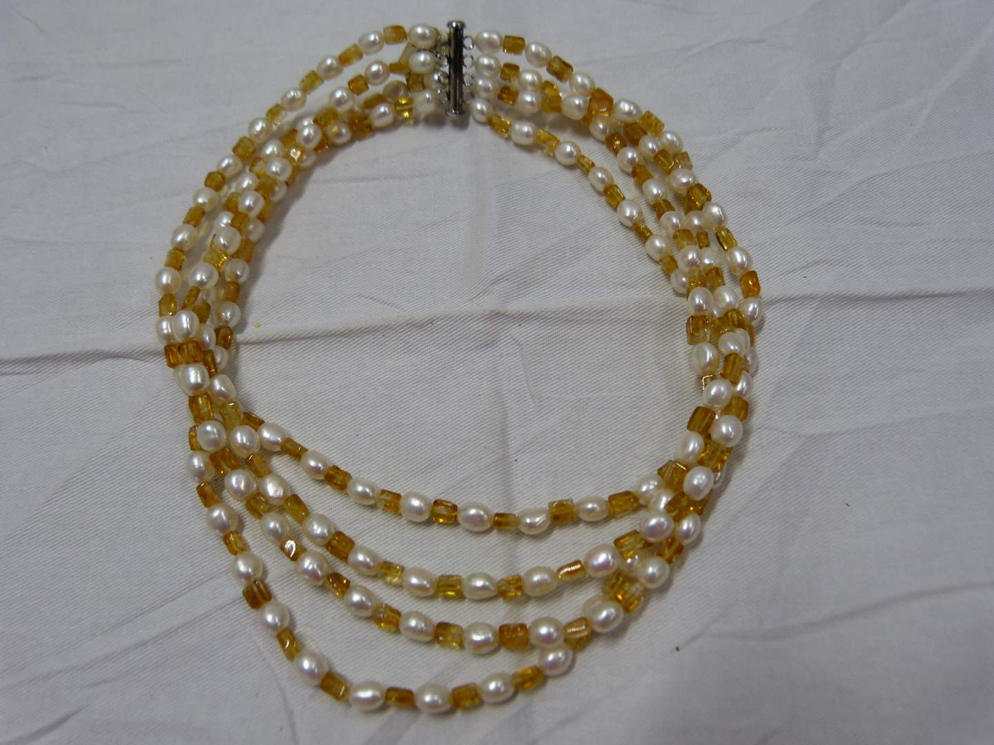 Lot # 96  Great triple strand pearls & topaz colored stones necklace with sterling silver clasp (main image)