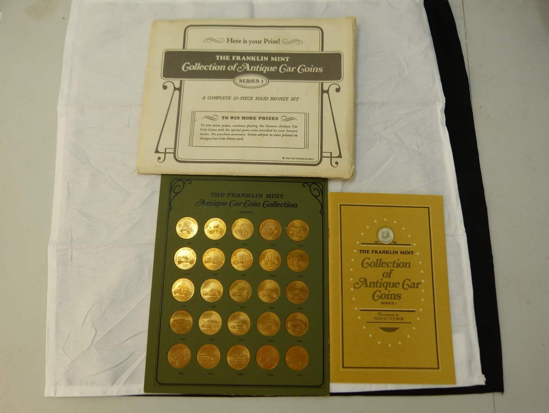 Lot # 101  Franklin Mint Collection of Antique Car Coins  25 piece set bronze (main image)