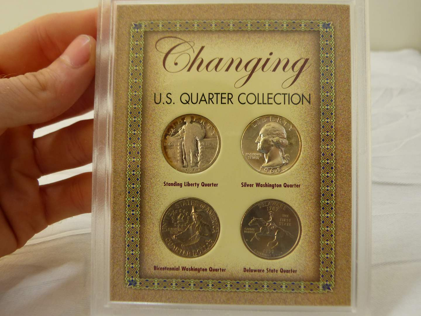 Lot # 106  Great display changing quarters to include silver