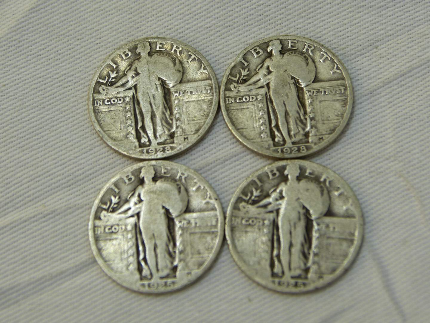 Lot # 122  4 US silver standing Liberty quarters various years & conditions (main image)