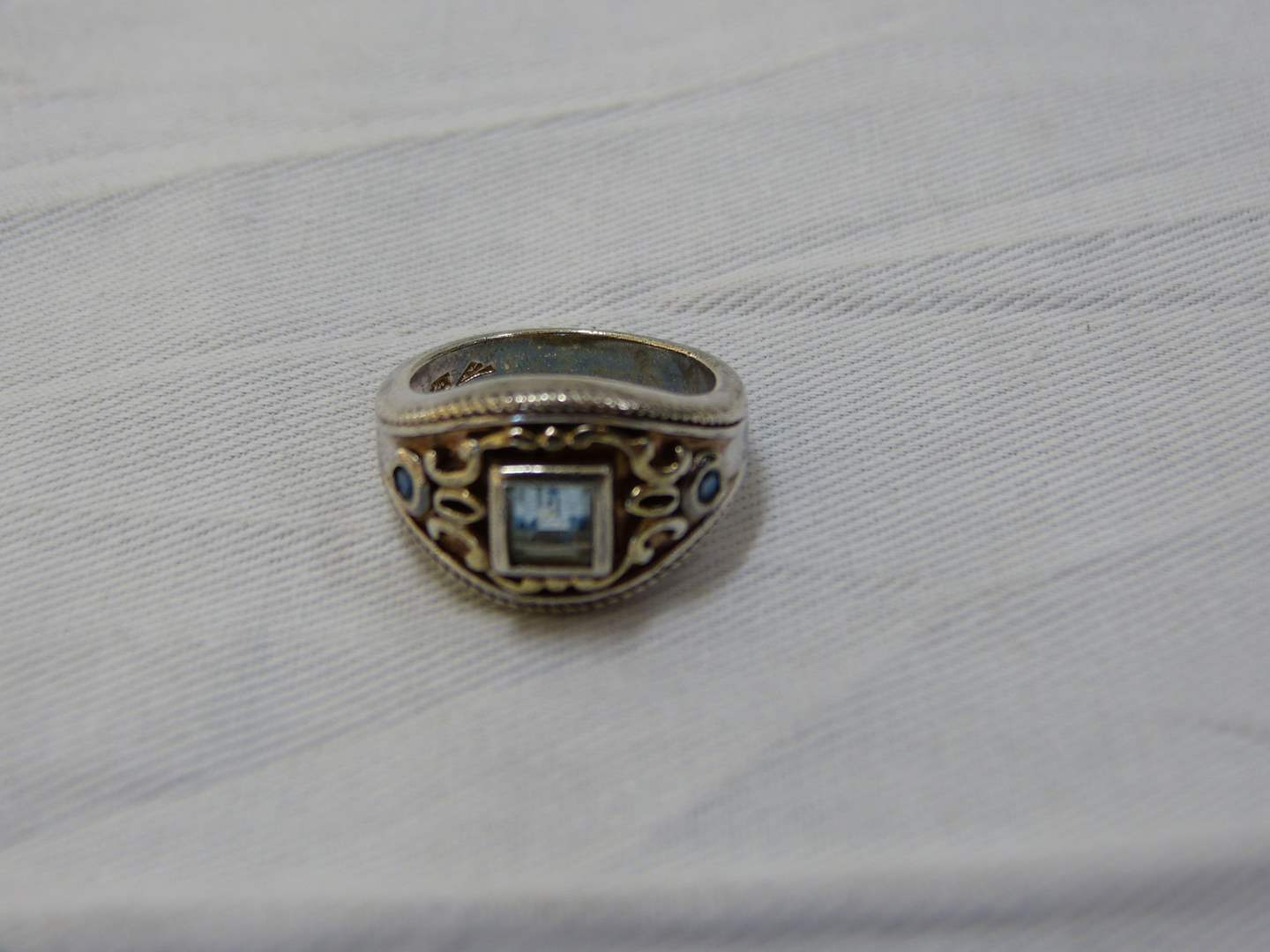 Lot # 134  Sterling silver & light blue stone ring size 8