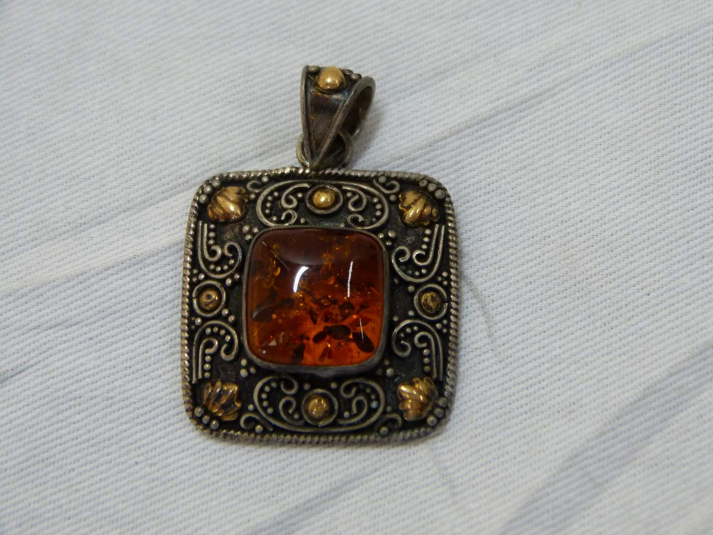 Lot # 136  Sterling w/18K gold accents amber pendant (main image)
