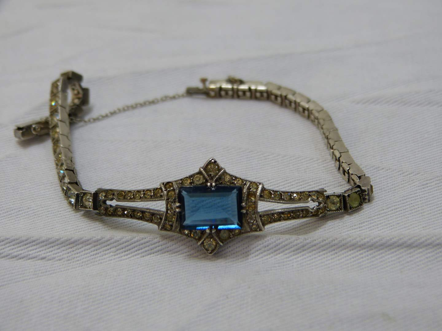 Lot # 141  Art Deco sterling silver cz's (there are a few missing) & blue stone bracelet
