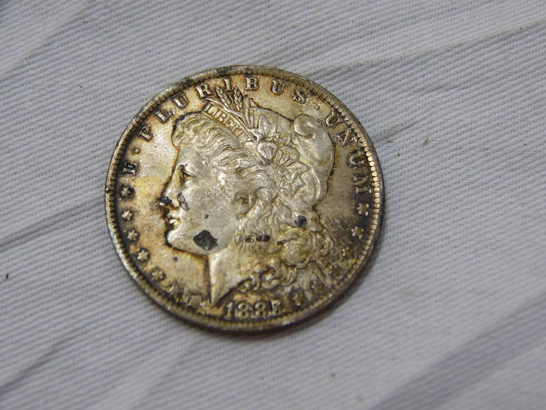 Lot # 159  1885-O Morgan silver dollar