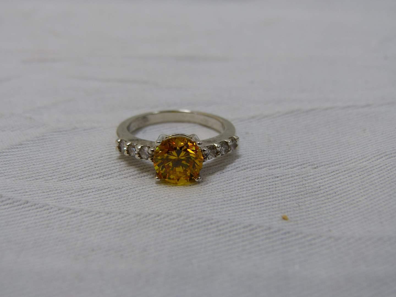 Lot # 182  Sterling silver & orange-yellow stone size 7 1/2 (main image)