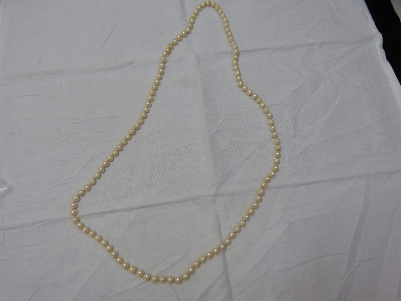 "Lot # 188  38"" strand 4mm pearls"