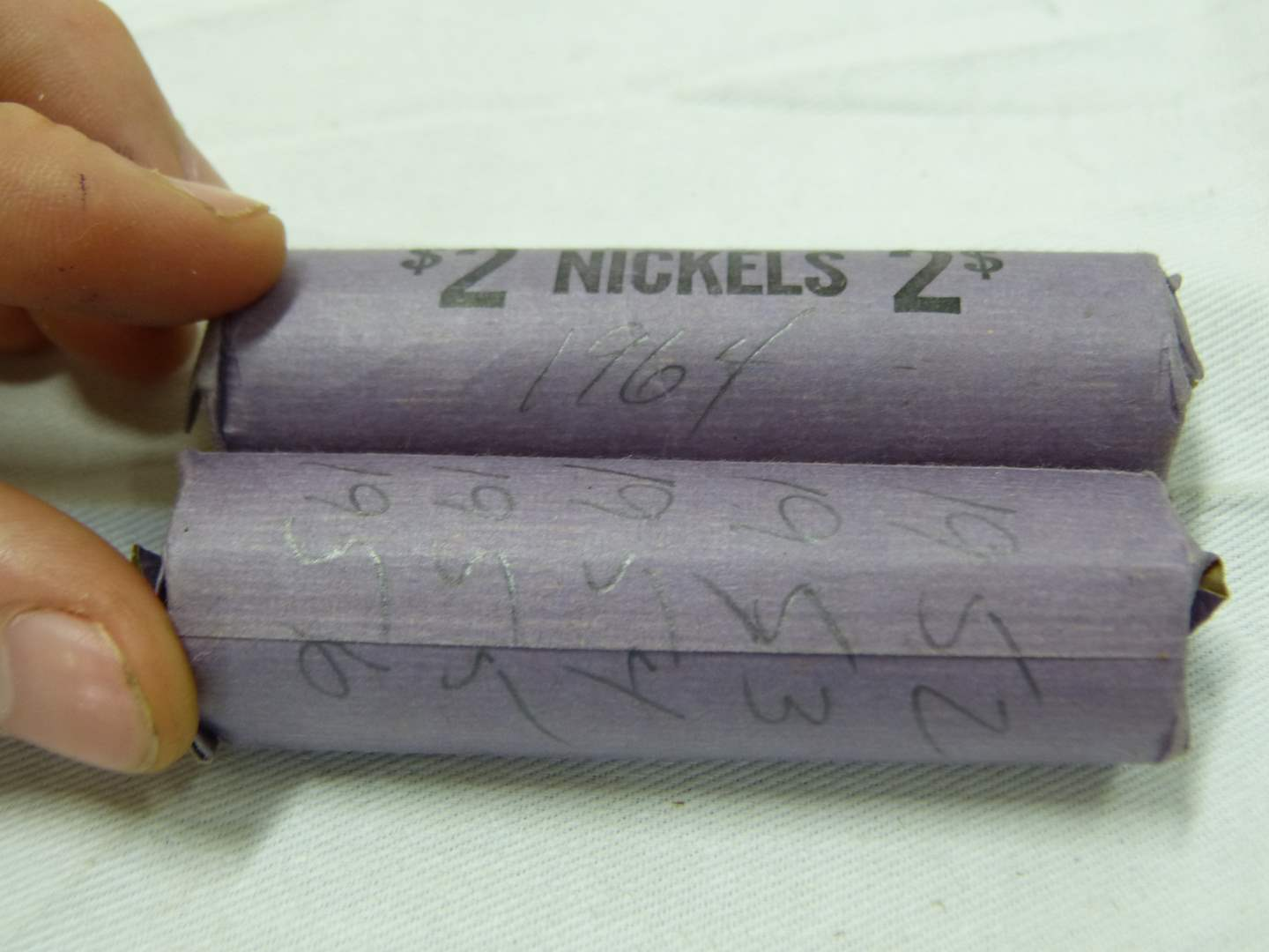 Lot # 220  2 rolls of various dates nickels (unsearched we are going by what the wrappers say)