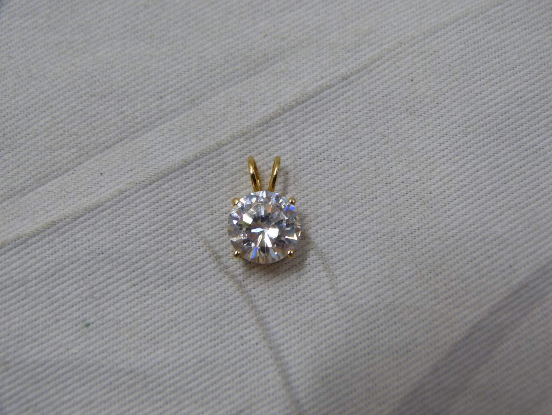 Lot # 230  Guaranteed 14K gold pendant with large CZ (main image)